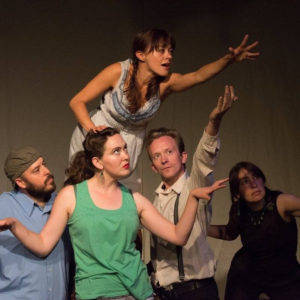 five cast members of the Virus Theater performing