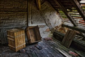 dilapidated attic with old wooden crates